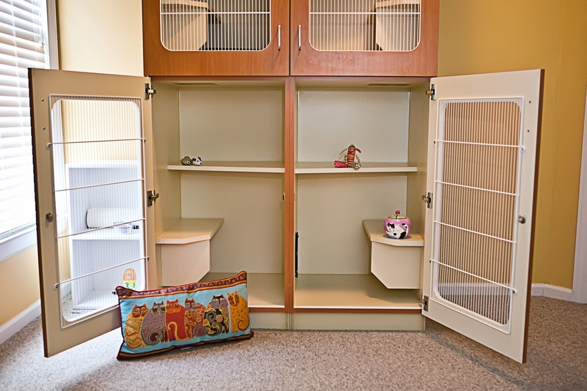 Our Kitty Condos Feature Multi-level Sleeping And A Separate Litter Area.